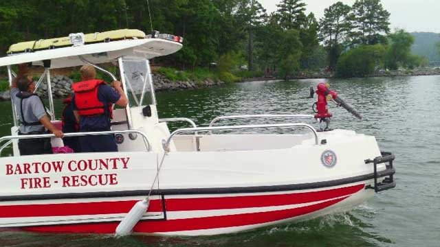 Ranger 1st Class Zack Hardy of the DNR Law Enforcement Division coordinates the recovery of a missing swimmer at Red Top Mountain State Park on Allatoona Lake with the Bartow County Fire and Rescue team. (Credit: Ga. DNR Law Enforcement)