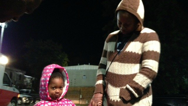 Four-year-old Leah Boozer and her mother escape apartment fire