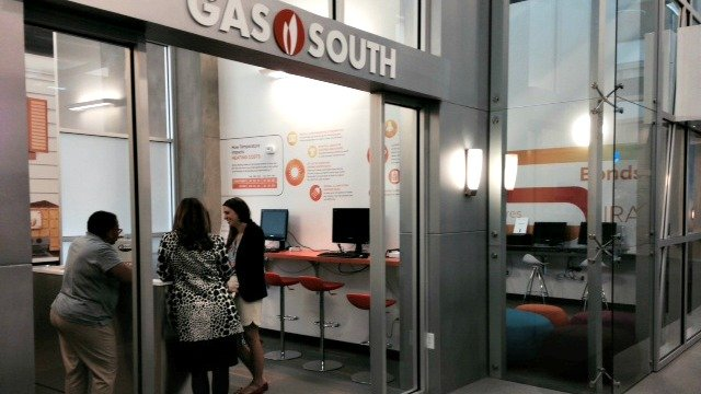 Volunteers from Gas South prepare for students to arrive