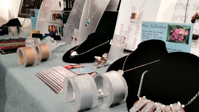 Eco-friendly designs include jewelry made from old Plexiglas signs