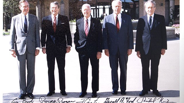Photos of U.S. presidents, including signatures
