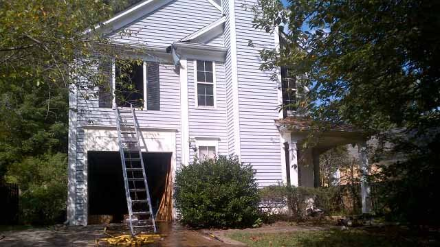 A fire caused damage to this home on Hampton Hill Ct. in Lawrenceville. (Courtesy: Capt. Tommy Rutledge / Gwinnett County Fire and Emergency Services)