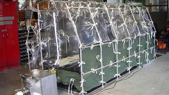 An aeromedical biological containment system will be used to transport Ebola patients. (AP Photo/CDC)