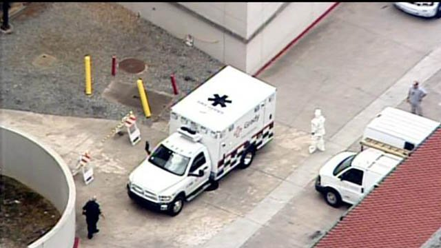 Medical staff in Hazmat suits wait to receive the first of two Ebola patients at Emory University Hospital.