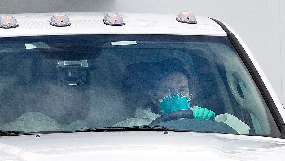 EMT Gail Stallings driving Ebola patient Dr. Kent Brantly to Emory University Hospital. (AP Photo)