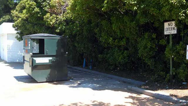 The child was found behind this dumpster.