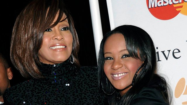 Bobbi Kristina Brown with her mother Whitney Houston in 2011. (Credit: Associated Press)
