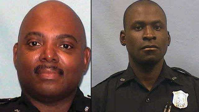 Officers Jeffery Cook (left) and Omar Thyme