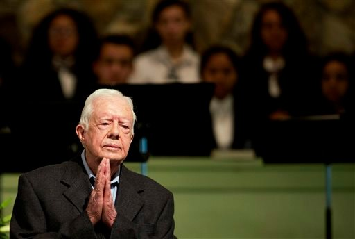 In a Sunday, Aug. 23, 2015 file photo, former President Jimmy Carter teaches Sunday School class at Maranatha Baptist Church in his hometown, in Plains, Ga. (AP Photo/David Goldman, File)