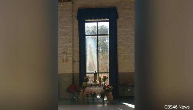 Churchgoers at a church in Marietta are flocking to see a 'miracle': the image of the Virgin Mary in a window there, just before Christmas 2015.
