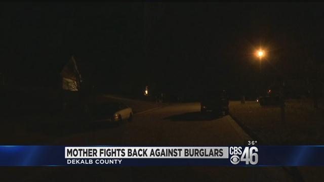 Mother fights back against burglars