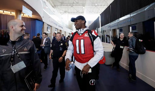 Atlanta Falcons wide receiver Julio Jones (11) jokes as he leaves a media availability for the NFL Super Bowl 51 football game Wednesday, Feb. 1, 2017, in Houston. Atlanta will face New England Patriots in the Super Bowl Sunday. (AP Photo/Eric Gay)